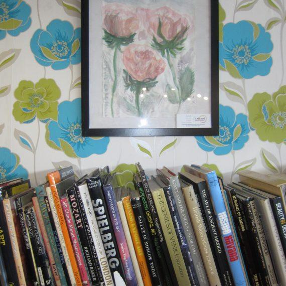 Английски книги и картина на бездомен творец в Лондон